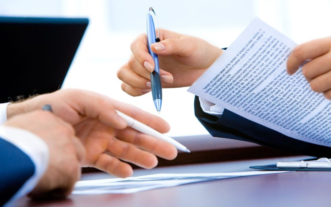two people reviewing documents